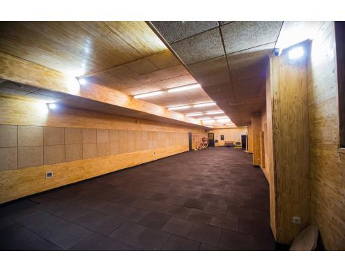 Ceiling and wall acoustic treatment in the shooting club
